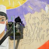 Нұр-Сұлтанда дәрігерлер құрметіне үйлердің қасбетінде сурет салынып жатыр
